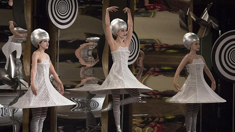 Dancers perform in the background of the presentation space moments before the Thom Browne Spring 2013 collection is modeled during Fashion Week in New York, Monday, Sept. 10, 2012. (AP Photo/John Minchillo)