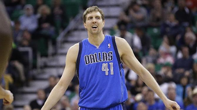 Dallas Mavericks' Dirk Nowitzki (41) looks on after scoring against the Utah Jazz in the second quarter during an NBA basketball game Wednesday, March 12, 2014, in Salt Lake City