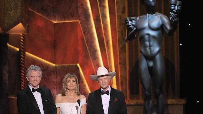 FILE - In this Sunday, Jan. 29, 2012 file photo, Patrick Duffy, left, Linda Gray, center, and Larry Hagman present the award for outstanding performance by an ensemble in a drama series at the 18th Annual Screen Actors Guild Awards in Los Angeles.  Actor Larry Hagman, who for more than a decade played villainous patriarch JR Ewing in the TV soap Dallas, has died at the age of 81, his family said Saturday Nov. 24, 2012.  (AP Photo/Mark J. Terrill, File)