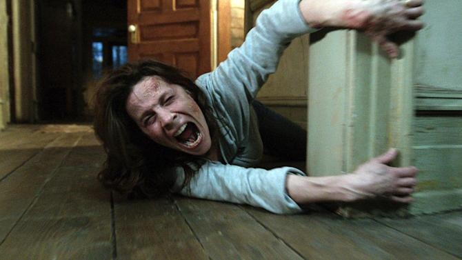 "In this publicity image released by Warner Bros. Pictures, Lili Taylor portrays Carolyn Perron in a scene from ""The Conjuring."" The film opens nationwide on Friday, July 19. (AP Photo/New Line Cinema/Warner Bros. Pictures)"