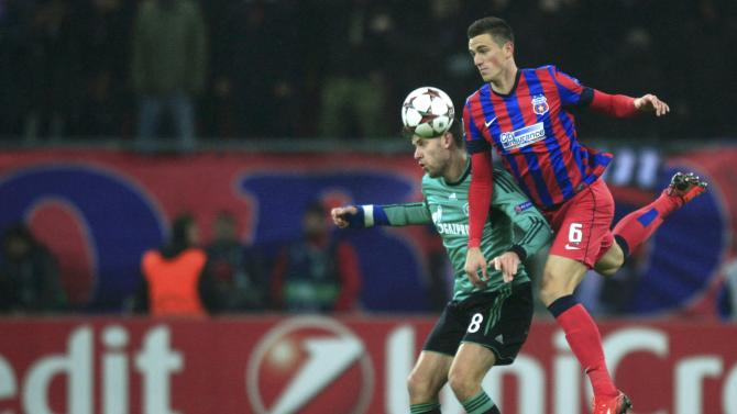 Schalke 04's Szalai challenges Steaua Bucharest's Gardos during their Champions League soccer match in Bucharest