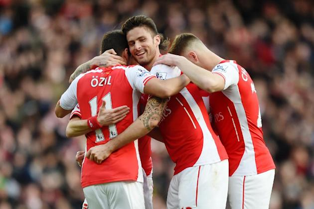 Football: Arsenal's Tomas Rosicky celebrates scoring their second goal with Olivier Giroud and Mesut Ozil