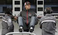 Nico Hulkenberg (C) of Germany looks on before the first practice session of the Austin F1 Grand Prix at the Circuit of the Americas in Austin November 15, 2013. REUTERS/Adrees Latif/Files