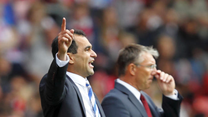 Roberto Martinez, left, praised Southampton's performance after Wigan beat them 2-0