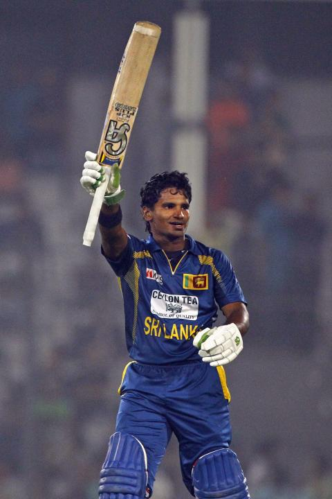 Sri Lanka's Kusal Perera acknowledges the crowed after scoring a century on the third one day international cricket match against Bangladesh in Dhaka, Bangladesh, Saturday, Feb. 22, 2014. Sri Lanka wo