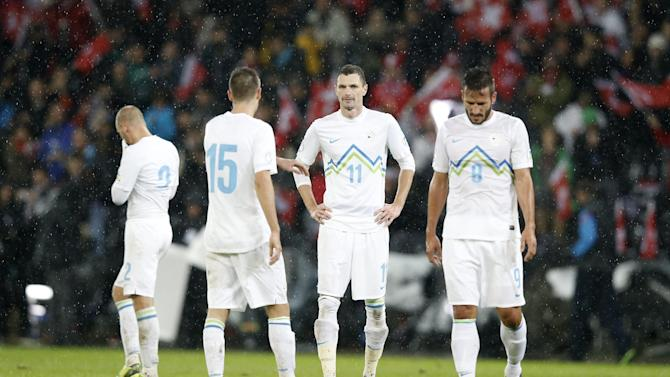 Slovenia's Miso Brecko, Andraz Struna, Milivoje Novakovic and Jasmin Kurtic, from left, look on after the FIFA World Cup 2014 group E qualifying soccer match between Switzerland and Slovenia at the Stade de Suisse stadium in Bern, Switzerland, Tuesday, October 15, 2013