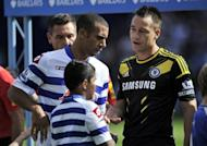Anton Ferdinand (L) refuses to shake hands with John Terry before a match earlier this month. The two met at Wembley as Terry's FA disciplinary hearing over allegations he racially abused Ferdinand started