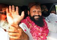 Malik Ishaq waves to supporters in July 2011 in Lahore as he is released on bail after nearly 14 years in prison. Pakistani Shiites on Saturday demanded that the head of a banned Sunni militant group be put on trial, a day after he was arrested following deadly sectarian attacks in the city of Quetta