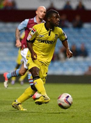 Ronnie Moore believes signings like Abdulai Bell-Baggie, pictured, have bolstered pace-setters Tranmere