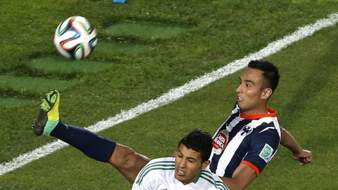 Abdelilah Hafidi of Morocco's Raja Casablanca fights for the ball with Jesus Zavala of Mexico's Monterrey during their FIFA Club World Cup soccer match in Agadir