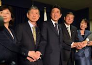 Japan's incoming Prime Minister and leader of Liberal Democratic Party (LDP) Shinzo Abe (C) shakes hands with his party's new executives: Seiko Noda (L), Masahiko Komura (2nd L), Shigeru Ishiba (2nd R) and Sanae Takaichi (R) at the LDP headquarters in Tokyo on December 25, 2012. Abe will return as the country's new prime minister and form his cabinet on December 26.