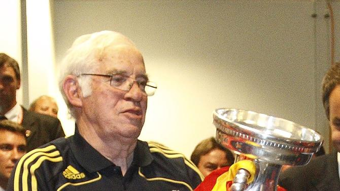 File photo of Spain national team coach Luis Aragones as he holds the trophy after the Euro 2008 final match in Vienna