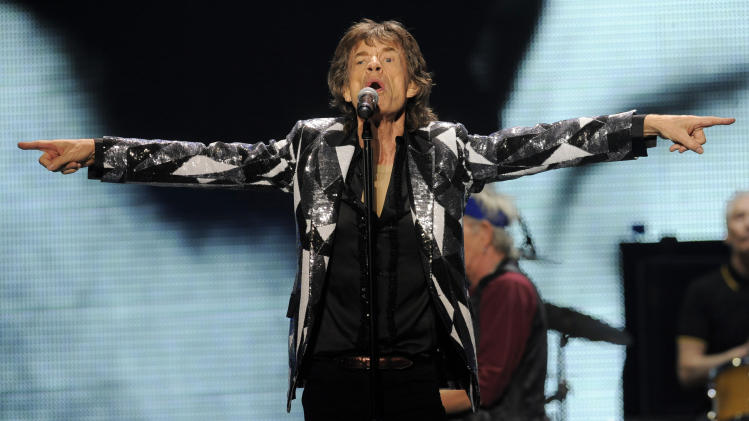 "Mick Jagger of the Rolling Stones performs at the kick-off of the band's ""50 and Counting"" tour at the Staples Center on Friday, May 3, 2013 in Los Angeles. (Photo by Chris Pizzello/Invision/AP)"