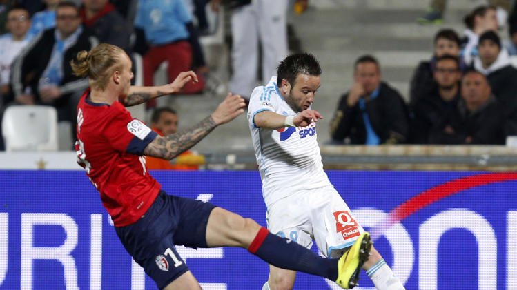 Olympique Marseille's Valbuena challenges Kjaer of Lille during their French Ligue 1 soccer match in Marseille