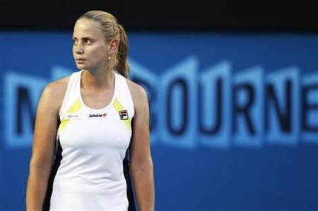 Dokic ofAustralia reacts during her women's singles match against Bartoli of France at the Australian Open tennis tournament in Melbourne