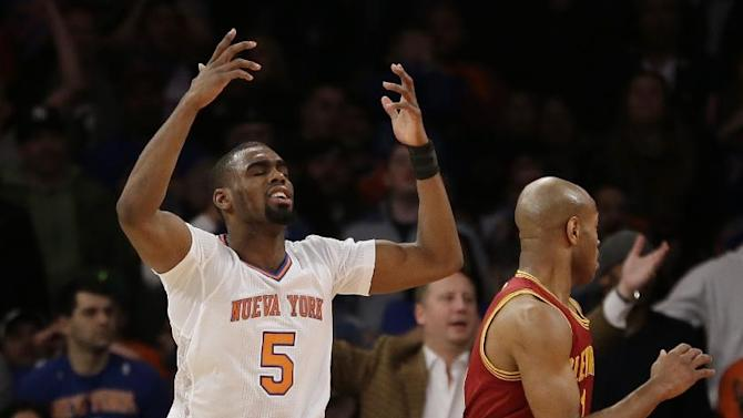 New York Knicks' Tim Hardaway Jr., left, reacts after missing a shot and not being fouled during the second half of the NBA basketball game against the Cleveland Cavaliers at Madison Square Garden, Sunday, March 23, 2014, in New York. The Cavaliers defeated the Knicks 106 to 100