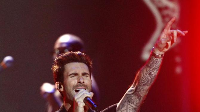 "FILE - In a Wednesday, Dec. 5, 2012 file photo, Adam Levine, of the musical group Maroon 5, performs at the Grammy Nominations Concert Live! at Bridgestone Arena, in Nashville, Tenn. Broadcast Music, Inc. announced Monday, April 8, 2013 that Levine will receive the president's award at the 61st annual BMI Pop Awards on May 14. BMI says it is honoring 34-year-old Levine because of his ""outstanding achievements in songwriting and the global impact he has had on pop culture."" (Photo by Wade Payne/Invision/AP, File)"