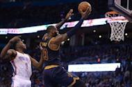 Feb 9, 2017; Oklahoma City, OK, USA; Cleveland Cavaliers forward LeBron James (23) drives to the basket in front of Oklahoma City Thunder forward Jerami Grant (9) during the second quarter at Chesapeake Energy Arena. Mandatory Credit: Mark D. Smith-USA TODAY Sports