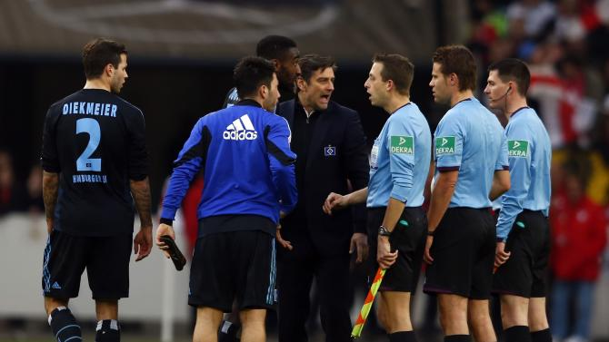 Hamburg players argue with referee Felix Brych after their German first division Bundesliga soccer match in Stuttgart