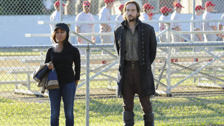 "In this Sept. 26, 2013 photo provided by Fox, the stars of ""Sleepy Hollow"" appear in a scene from the TV show. Nicole Beharie, left, plays police Lt. Abbie Mills and Tom Mison plays Ichabod Crane. The new show, inspired by the tale of the Headless Horseman, has spurred interest in the village of Sleepy Hollow, N.Y. (AP Photo/Fox)"
