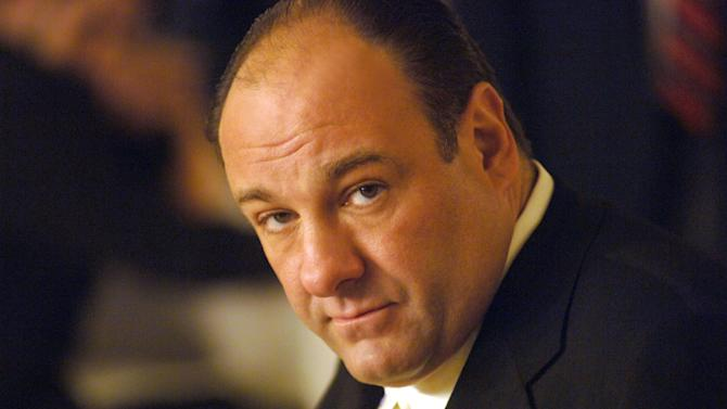 "FILE - This undated publicity photo released by HBO, shows actor James Gandolfini in his role as Tony Soprano, head of the New Jersey crime family portrayed in HBO's ""The Sopranos."" Funeral services for actor James Gandolfini are scheduled for Thursday, June 27, 2013, at the Cathedral Church of Saint John the Divine in New York City. Gandolfini died June 19, 2013 in Italy. He was 51. (AP Photo/HBO, Barry Wetcher, File)"