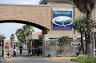 The entrance to the estate where Oscar Pistorius lives in Pretoria East, pictured February 14, 2013. Police have charged South Africa's Olympic amputee sprint star with the Valentine's Day murder of his glamorous model girlfriend, but played down reports she was mistaken for a burglar
