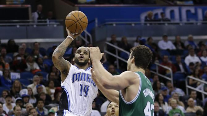 Orlando Magic's Jameer Nelson (14) takes a shot over Boston Celtics' Kris Humphries (43) during the second half of an NBA basketball game in Orlando, Fla., Sunday, Jan. 19, 2014. Orlando won 93-91