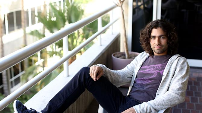 "In this Tuesday, June 18, 2013 photo, Adrian Grenier poses for a portrait in Los Angeles. Grenier is promoting his new documentary, ""How to Make Money Selling Drugs,"" which he produced. He also stars in an upcoming ""Entourage"" film, that he says has been green lit for production. (Photo by Matt Sayles/Invision/AP)"