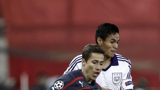 Anderlecht's Najar challenges Olympiakos' Fuster during their Champions League soccer match in Athens