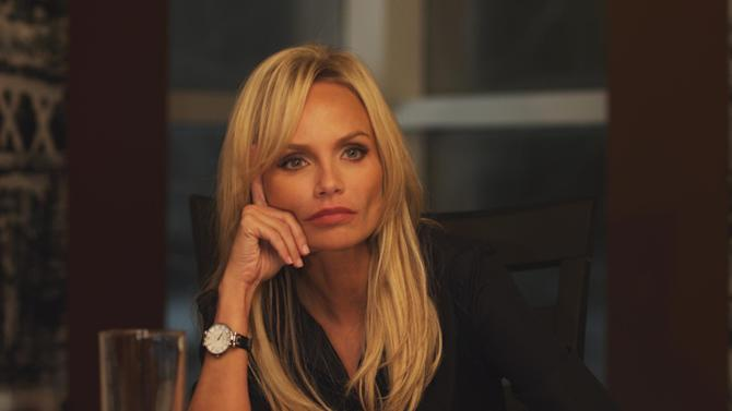 """This publicity photo released by ARC Entertainment shows Kristin Chenoweth as Samantha Smith-Dungy in a scene from the film, """"Family Weekend."""" The film releases Friday, March 29, 2013. (AP Photo/ARC Entertainment)"""