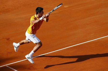 Djokovic of Serbia returns the ball to Federer of Switzerland during their final match at the Rome Open tennis tournament in Rome
