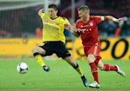 Bayern Munich's midfielder Bastian Schweinsteiger (R) fights for the ball with Dortmund's striker Robert Lewandowski during the German cup final football match at the Olympiastadion in Berlin. Dortmund beat Champions League finalists Bayern Munich 5-2 in Saturday's German Cup final to claim the first domestic double in their 103-year history