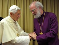 Pope Benedict XVI (left) greets the Archbishop of Canterbury Rowan Williams -- the spiritual leader of the world's Anglicans -- at the Vatican on October 9