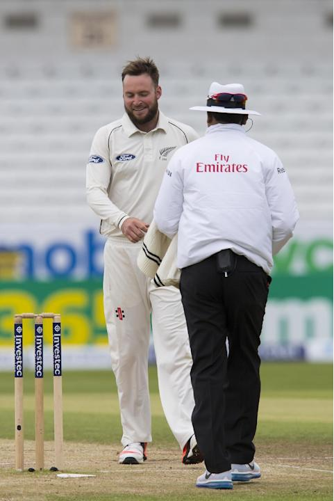 New Zealand's Mark Craig smiles as he bowls the first over on the fifth day of the second Test match between England and New Zealand at Headingley cricket ground in Leeds, England, Tuesday, June 2
