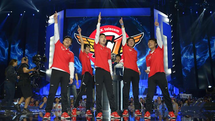 Members of South Korea's SK Telecom T1 team celebrate after defeating China's Royal Club at the League of Legends Season 3 World Championship Final, Friday, Oct. 4, 2013, in Los Angeles. The SK Telecom T1 team won 3-0. (AP Photo/Mark J. Terrill)