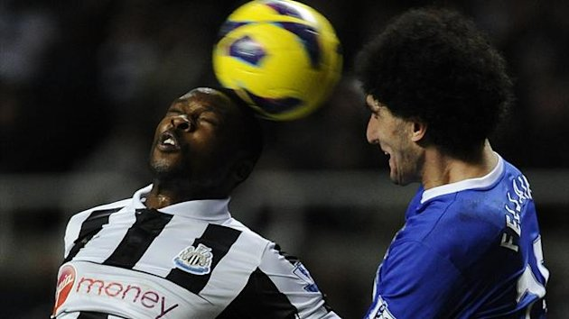 Everton's Marouane Fellaini (R) challenges Newcastle United's Shola Ameobi (Reuters)
