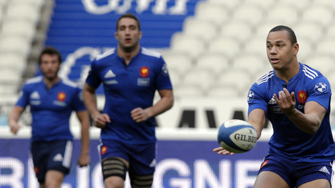 France's Gael Fickou passes the ball during a training session at the stade de France stadium, in Saint Denis, outside Paris, Friday, March 14, 2014. France will play Ireland during a Six Nations Rugby Union match on March 15. (AP Photo/Christophe Ena)