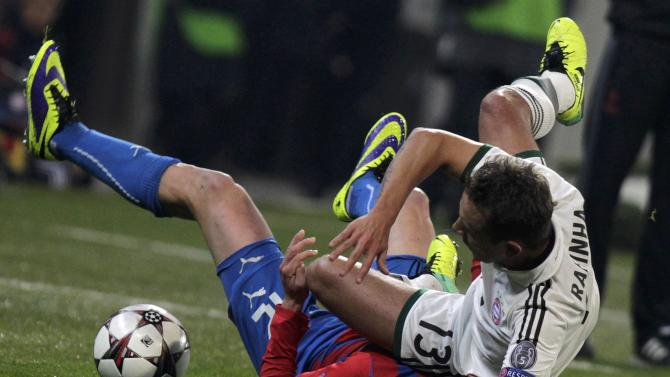 Bayern Munich's Rafinha collides with Viktoria Plzen's Duris during their Champions League soccer match in Plzen