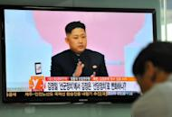 """A South Korean man watches a TV newscast reporting about the """"marshal"""" title of North Korea's leader Kim Jong-Un at a railway station in Seoul"""