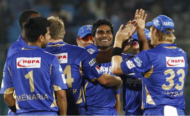 Rajasthan Royals players celebrate fall of a wicket during CLT20 match between Rajasthan Royals and Otago Volts at Sawai Mansingh Stadium in Jaipur on Oct. 1, 2013. (Photo: IANS)