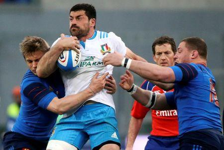 France's Plisson and Kaiser tackle Italy's Masi during their Six Nations Rugby Union match at the Olympic stadium in Rome