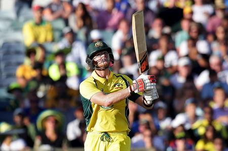 Australia's Steve Smith watches the ball after he hit it for a six during their One Day International cricket match against India in Perth