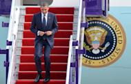 US President Barack Obama walks down the airplane stairs after his arrival at Don Mueang International airport in Bangkok. Myanmar said on Sunday it would agree to new atomic safeguards that allow inspections of suspected clandestine nuclear sites, ahead of a milestone visit by Obama