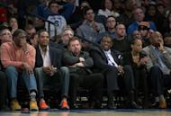Madison Square Garden chairman James Dolan, center left, sits with former New York Knicks team members and others as he watched the Knicks take on the San Antonio Spurs during an NBA basketball game at Madison Square Garden in New York, Sunday, Feb. 12, 2017. (AP Photo/Craig Ruttle)