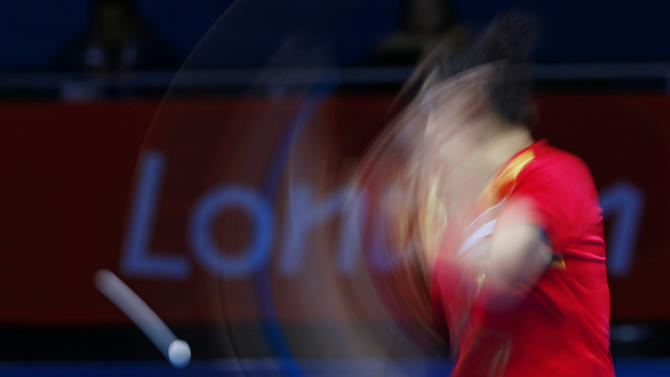Singapore's Feng Tianwei hits a return to South Korea's Kim Kyungah in their women's team bronze medal table tennis singles match at the ExCel venue during the London 2012 Olympic Games