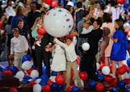 Sam Ryan plays with a giant balloon as the families of Republican presidential candidate Mitt Romney and vice presidential candidate, Paul Ryan stand on stage during the final day of the Republican National Convention at the Tampa Bay Times Forum on August 30, in Tampa, Florida