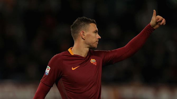 Dzeko on target as Roma stay on Juve's tail