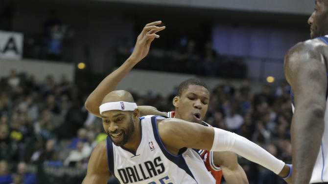 Dallas Mavericks guard Vince Carter (25) gets past Milwaukee Bucks forward John Henson (31) during the second half of an NBA basketball game Saturday, Dec. 14, 2013, in Dallas. The Mavericks won 106-93
