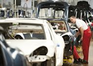 Workers assemble a Porsche Panamera model on the production line of the Porsche plant in Leipzig, March 2012. Eurozone industrial production rose a sharp 0.6 percent in the euro area in July after a 0.6 percent contraction the previous month