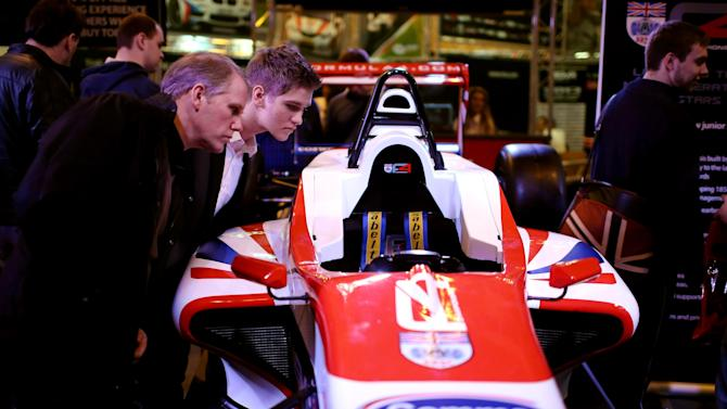 Racing And Car Enthusiasts Enjoy The Exhibits At The 2013 Autosport International Show